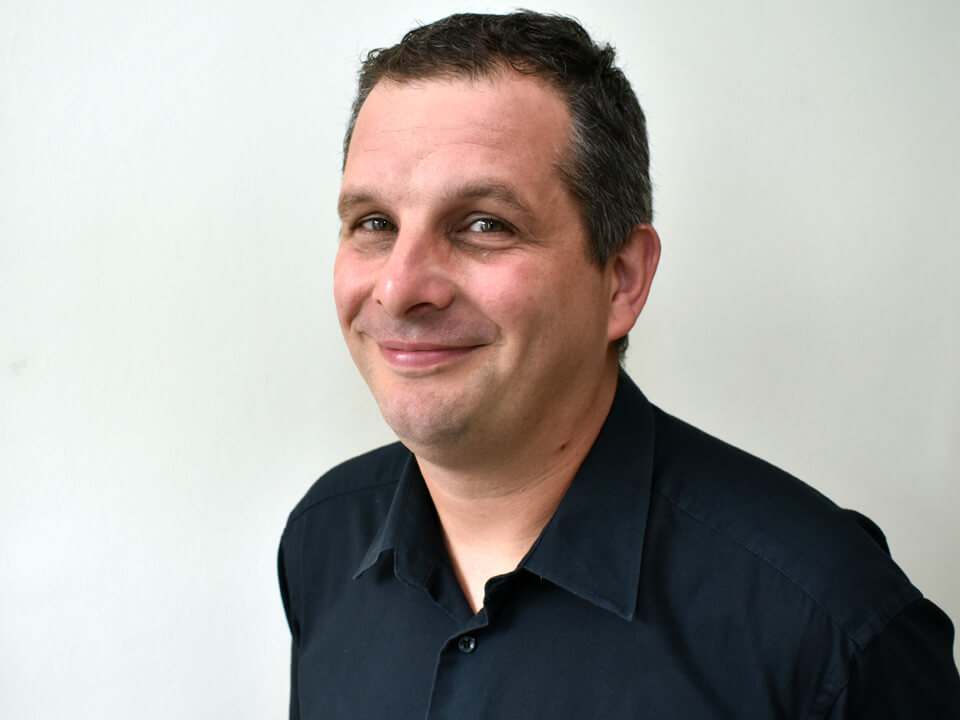 smiling man in a black shirt